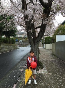 Masaki with cherry blossoms, Tokyo, 2015, photo by Rie Yamada
