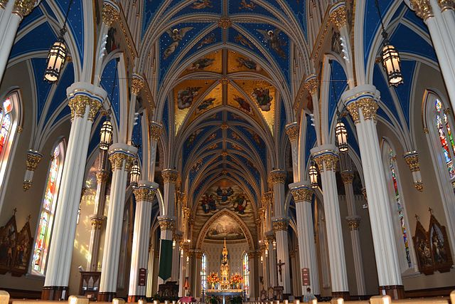 Interior of basilica withornate blue and gold vaulted ceiling